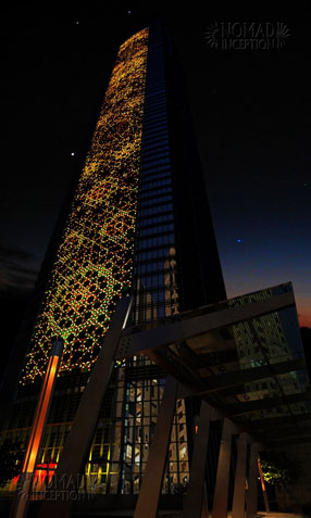 Tower façade with illuminated interlaces